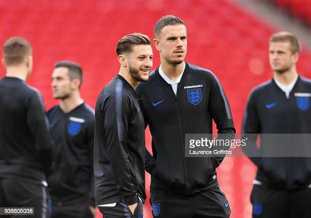 Adam Lallana of England and Jordan Henderson speak while taking a look around the pitch prior to the International friendly between England and Italy...
