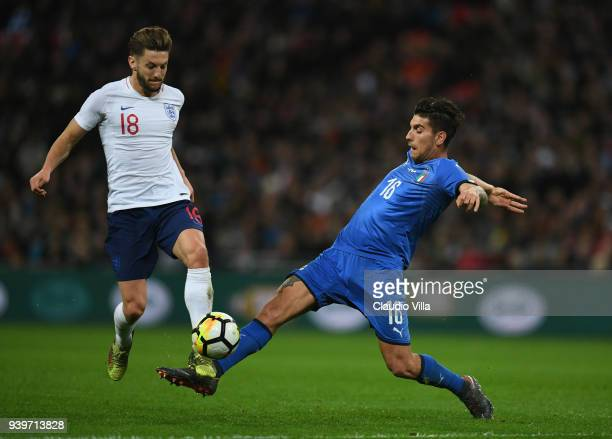 Adam Lallana of England and Lorenzo Pellegrini of Italy compete for the ball during the friendly match between England and Italy at Wembley Stadium...