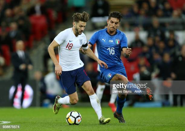 Adam Lallana of England and Lorenzo Pellegrini of Italy during the International Friendly match between England and Italy at Wembley Stadium on March...