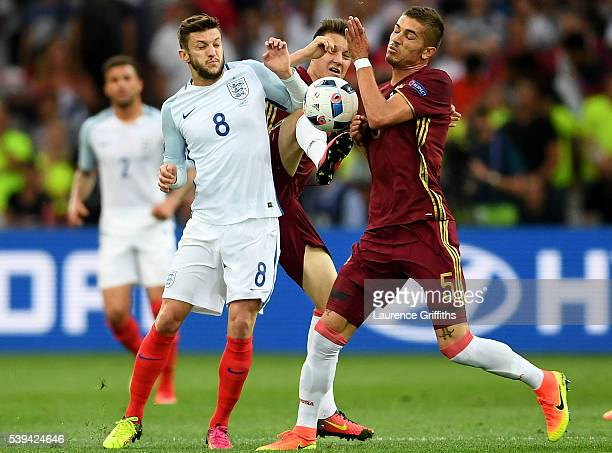 Adam Lallana of England and Roman Neustadter of Russia compete for the ball during the UEFA EURO 2016 Group B match between England and Russia at...