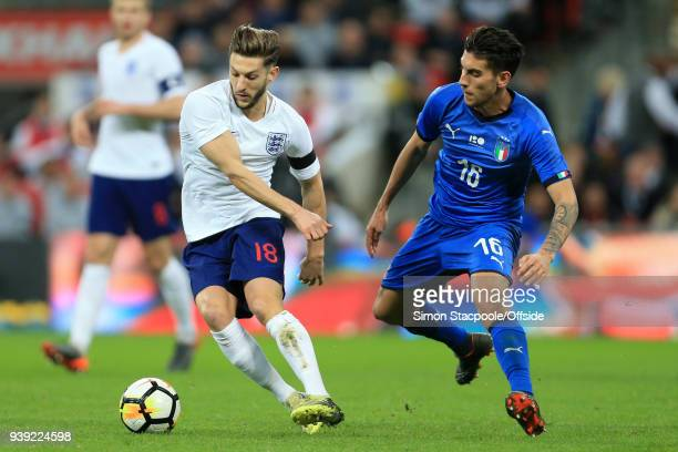 Adam Lallana of England battles with Lorenzo Pellegrini of Italy during the international friendly match between England and Italy at Wembley Stadium...
