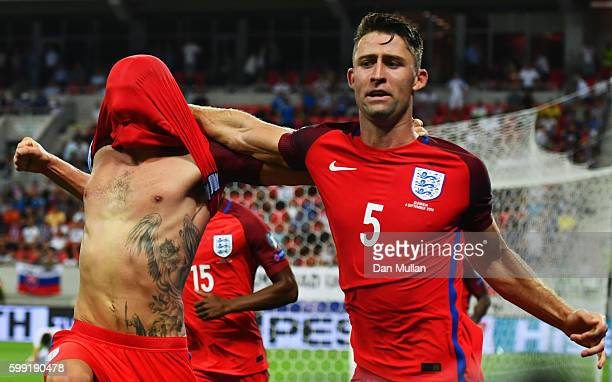 Adam Lallana of England celebrates with Gary Cahill of England as he scores their first goal during the 2018 FIFA World Cup Group F qualifying match...