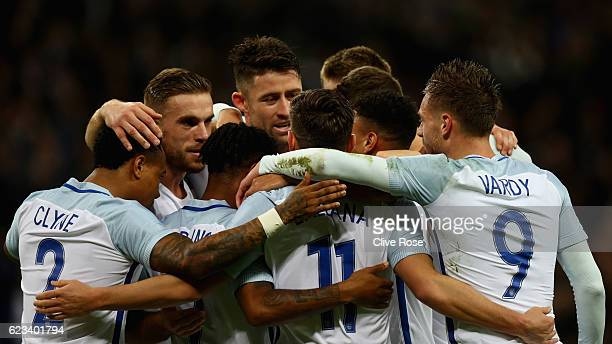 Adam Lallana of England celebrates with team mates after scoring the opening goal during the international friendly match between England and Spain...