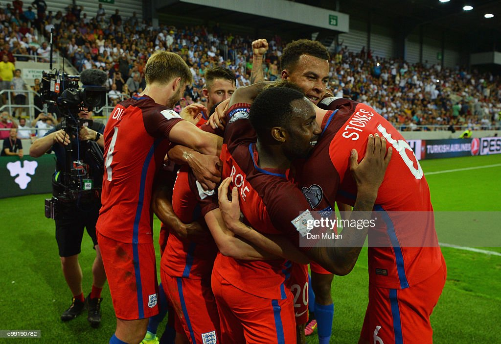 Adam Lallana of England (obscured) celebrates with team mates as he scores their first goal during the 2018 FIFA World Cup Group F qualifying match between Slovakia and England at City Arena on September 4, 2016 in Trnava, Slovakia.