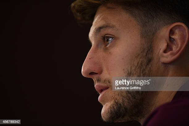 Adam Lallana of England faces the media during a Press Conference during a training session at St Georges Park on October 7 2014 in BurtonuponTrent...