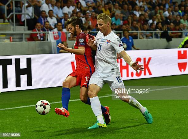 Adam Lallana of England holds off Tomas Hubocan of Slovakia during the 2018 FIFA World Cup Group F qualifying match between Slovakia and England at...
