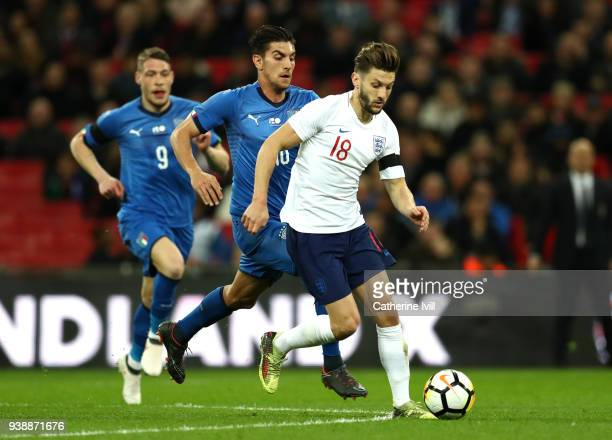 Adam Lallana of England is challenged by Lorenzo Pellegrini of Italy during the International friendly between England and Italy at Wembley Stadium...