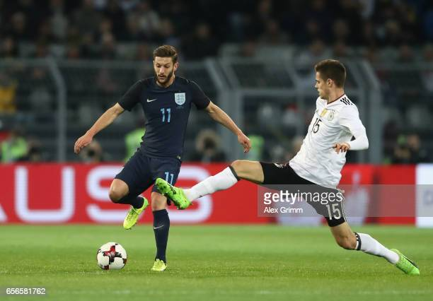 Adam Lallana of England is put under pressure from Julian Weigl of Germany during the international friendly match between Germany and England at...