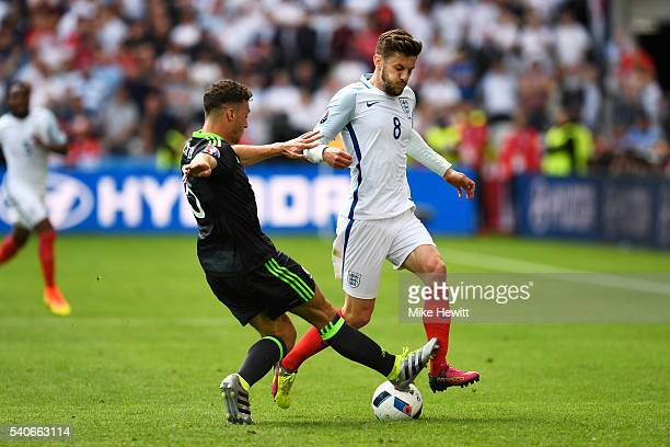 Adam Lallana of England is tackled by James Chester of Wales during the UEFA EURO 2016 Group B match between England and Wales at Stade...