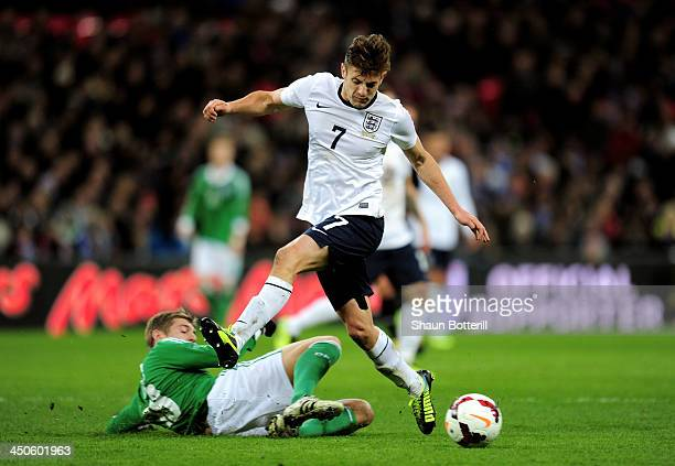 Adam Lallana of England is tackled by Toni Kroos of Germany during the international friendly match between England and Germany at Wembley Stadium on...