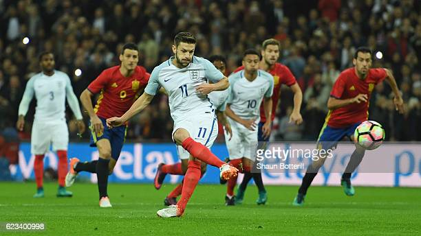 Adam Lallana of England scores the opening goal of the game from the penalty spot past goalkeeper Pepe Reina of Spain during the international...