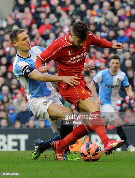 Adam Lallana of Liveprool competes with Matthew Kilgallon of Blackburn Rovers during the FA Cup Quarter Final match between Liverpool and Blackburn...
