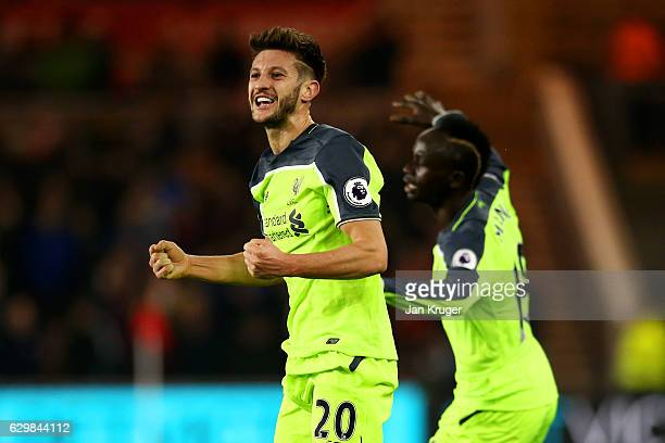 Adam Lallana of Liverpol celebrates scoring his sides first goal with Sadio Mane of Liverpool during the Premier League match between Middlesbrough...