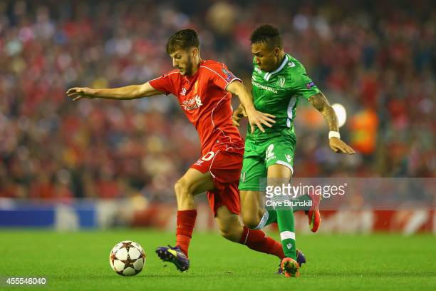 Adam Lallana of Liverpool and Anicet Abel of PFC Ludogorets Razgrad battle for the ball during the UEFA Champions League Group B match between...