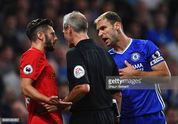 Adam Lallana of Liverpool and Branislav Ivanovic of Chelsea appeal to referee Martin Atkinson during the Premier League match between Chelsea and...