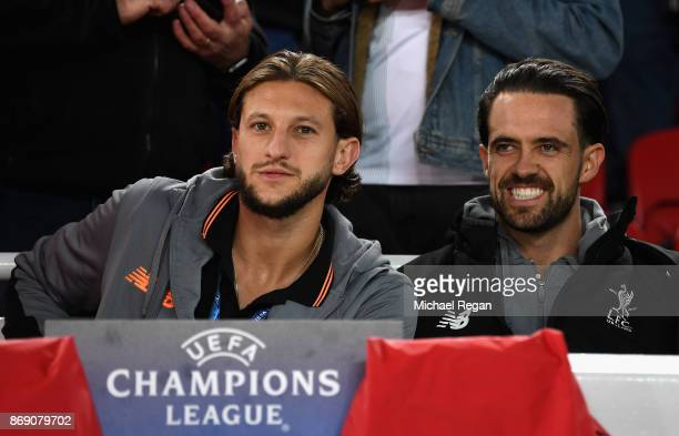 Adam Lallana of Liverpool and Danny Ings of Liverpool look on during the UEFA Champions League group E match between Liverpool FC and NK Maribor at...