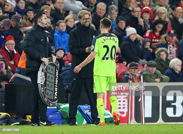 Adam Lallana of Liverpool and Jurgen Klopp Manager of Liverpool embrace after he is subbed during the Premier League match between Middlesbrough and...