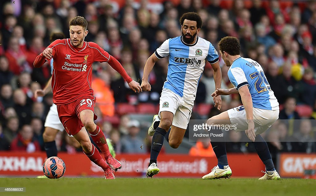 Adam Lallana of Liverpool and Lee Williamson of Blackburn Rovers compete during the FA Cup Quarter Final match between Liverpool and Blackburn Rovers at Anfield on March 8, 2015 in Liverpool, England.
