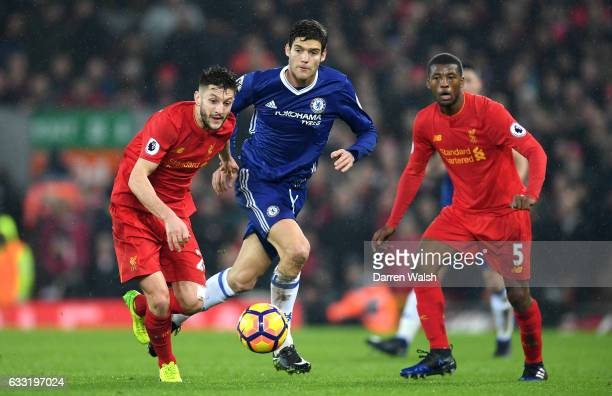 Adam Lallana of Liverpool and Marcos Alonso of Chelsea compete for the ball during the Premier League match between Liverpool and Chelsea at Anfield...