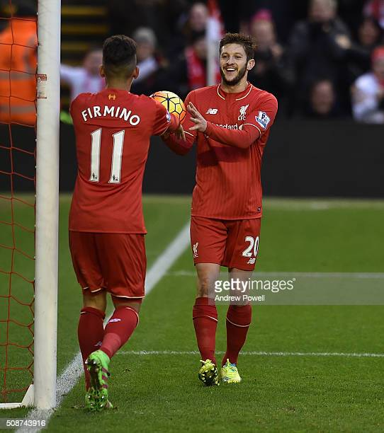 Adam Lallana of Liverpool and Roberto Firmino of Liverpool cdelebrate the second goal during the Barclays Premier League match between Liverpool and...