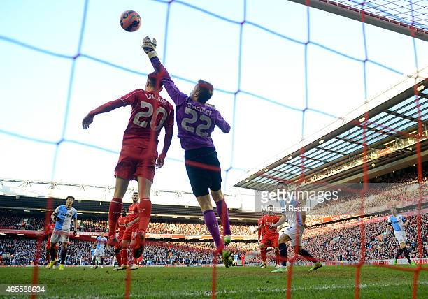 Adam Lallana of Liverpool and Simon Mignolet of Liverpool combine to keep the ball out of their goal during the FA Cup Quarter Final match between...