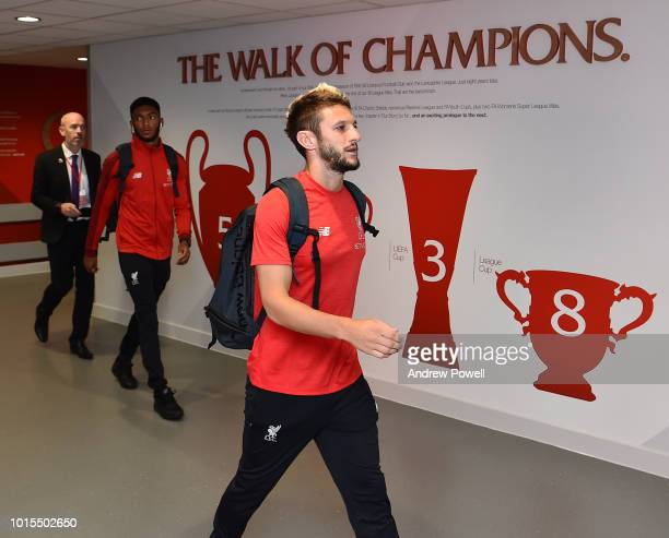 Adam Lallana of Liverpool arrives before the Premier League match between Liverpool FC and West Ham United at Anfield on August 12 2018 in Liverpool...