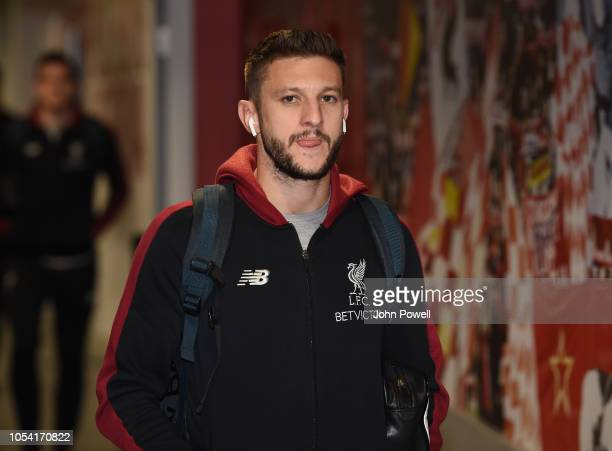 Adam Lallana of Liverpool arrives before the Premier League match between Liverpool FC and Cardiff City at Anfield on October 27 2018 in Liverpool...