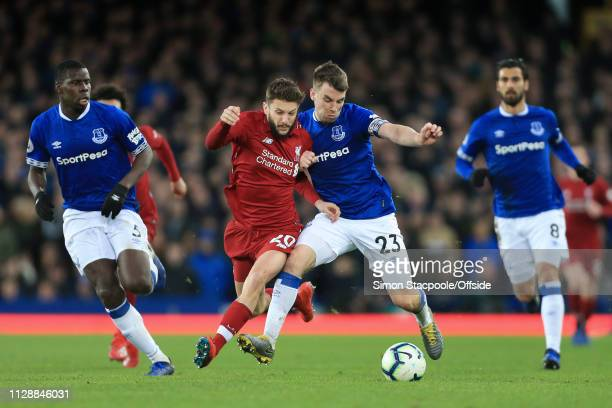 Adam Lallana of Liverpool battles with Seamus Coleman of Everton during the Premier League match between Everton and Liverpool at Goodison Park on...