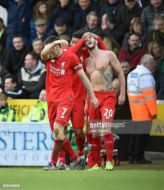 Adam Lallana of Liverpool celebrates after scoring during the Barclays Premier League match between Norwich City and Liverpool at Carrow Road on...