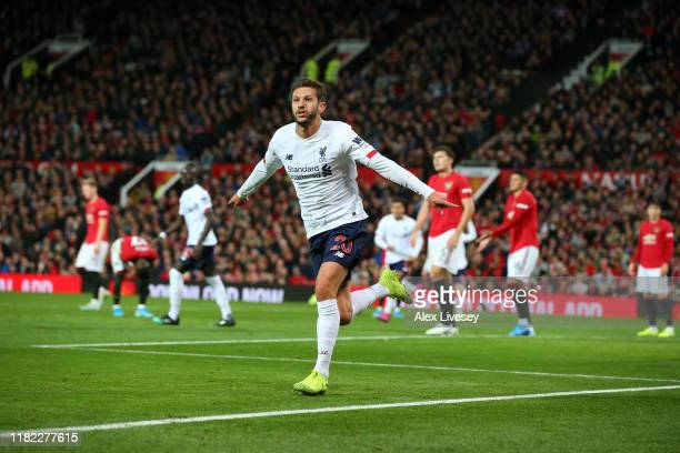 Adam Lallana of Liverpool celebrates after scoring his sides first goal during the Premier League match between Manchester United and Liverpool FC at...