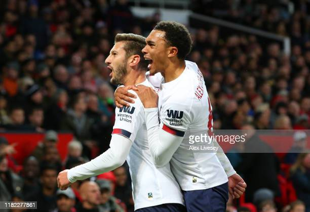 Adam Lallana of Liverpool celebrates after scoring his sides first goal with Trent Alexander-Arnold of Liverpool during the Premier League match...
