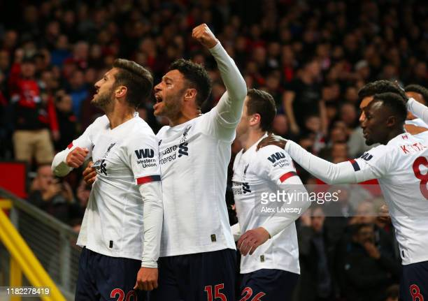 Adam Lallana of Liverpool celebrates after scoring his sides first goal with Alex OxladeChamberlain of Liverpool during the Premier League match...