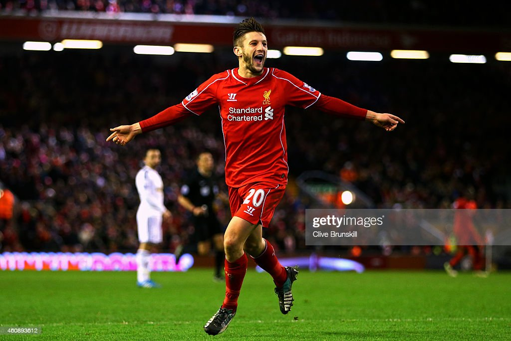 Adam Lallana of Liverpool celebrates after scoring his team's second goal during the Barclays Premier League match between Liverpool and Swansea City at Anfield on December 29, 2014 in Liverpool, England.
