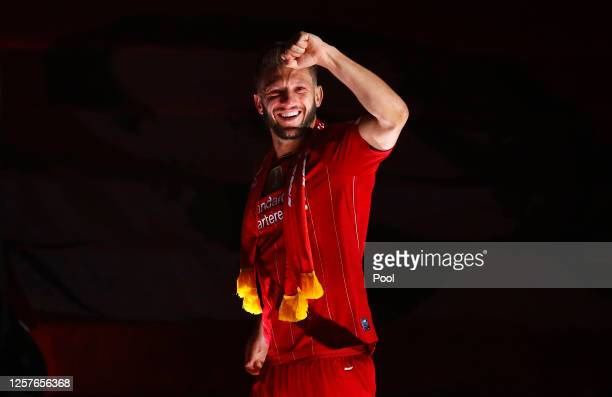 Adam Lallana of Liverpool celebrates following the Premier League match between Liverpool FC and Chelsea FC at Anfield on July 22, 2020 in Liverpool,...