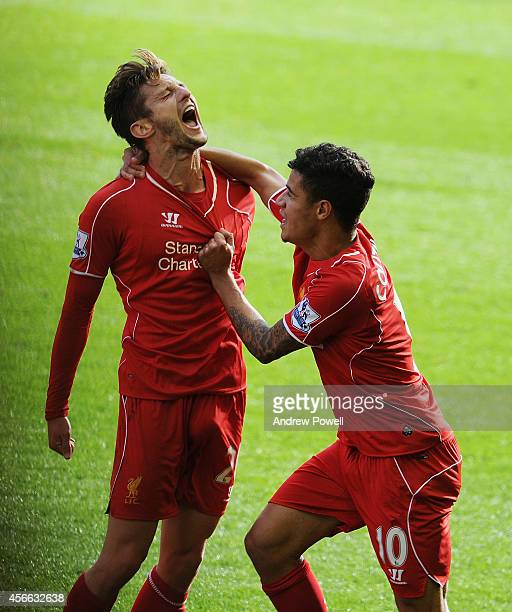 Adam Lallana of Liverpool celebrates his goal with Philippe Coutinho of Liverpool during the Barclays Premier League match between Liverpool and West...