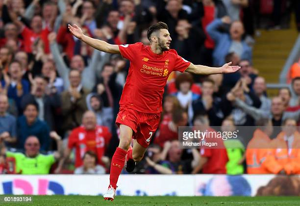 Adam Lallana of Liverpool celebrates scoring his sides third goal during the Premier League match between Liverpool and Leicester City at Anfield on...