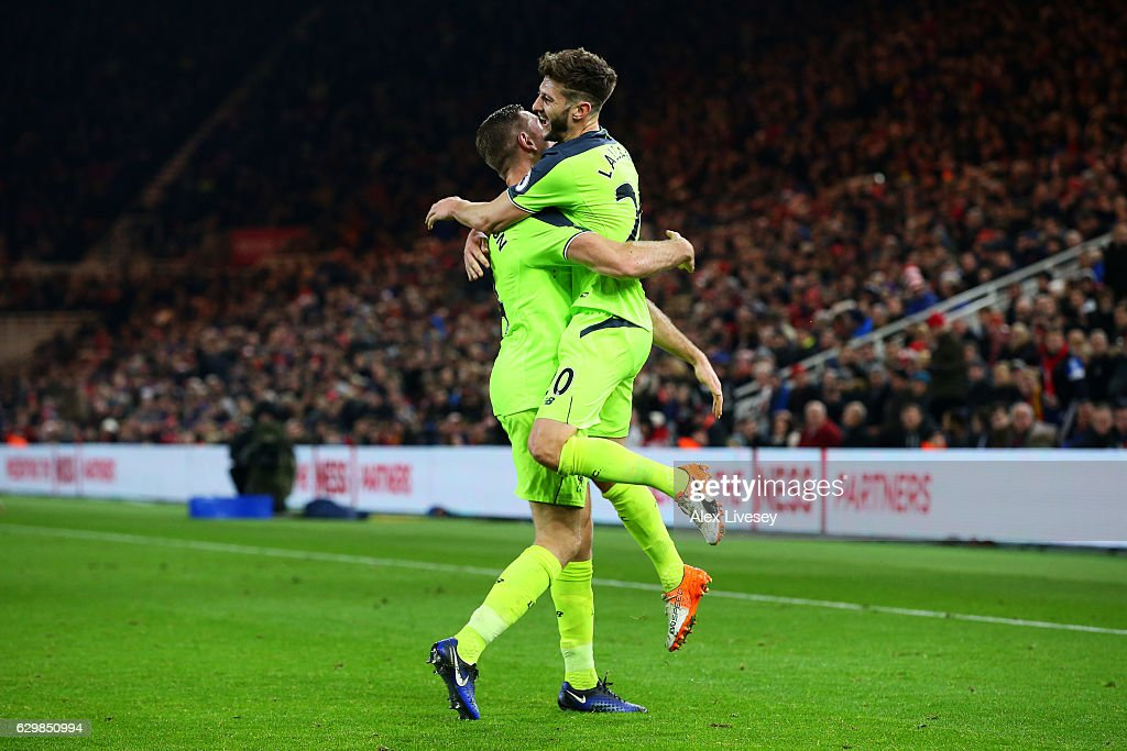 Adam Lallana of Liverpool (R) celebrates scoring his sides third goal with Jordan Henderson of Liverpool (L) during the Premier League match between Middlesbrough and Liverpool at Riverside Stadium on December 14, 2016 in Middlesbrough, England.