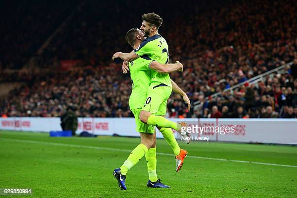 Adam Lallana of Liverpool celebrates scoring his sides third goal with Jordan Henderson of Liverpool during the Premier League match between...