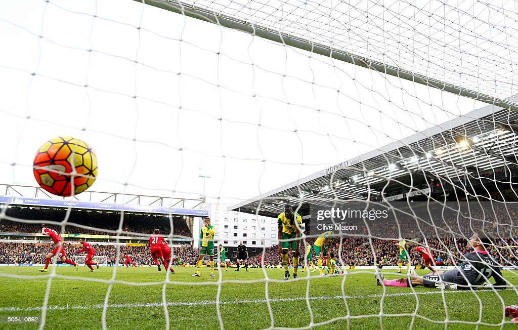 Adam Lallana (1st L) of Liverpool celebrates scoring his team's fifth goal during the Barclays Premier League match between Norwich City and Liverpool at Carrow Road on January 23, 2016 in Norwich, England.