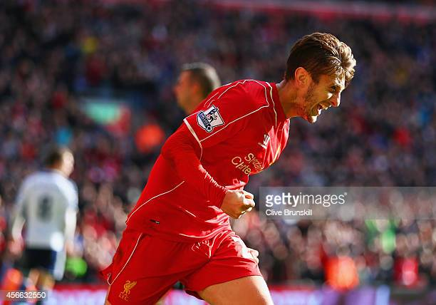 Adam Lallana of Liverpool celebrates scoring the opening goal during the Barclays Premier League match between Liverpool and West Bromwich Albion at...