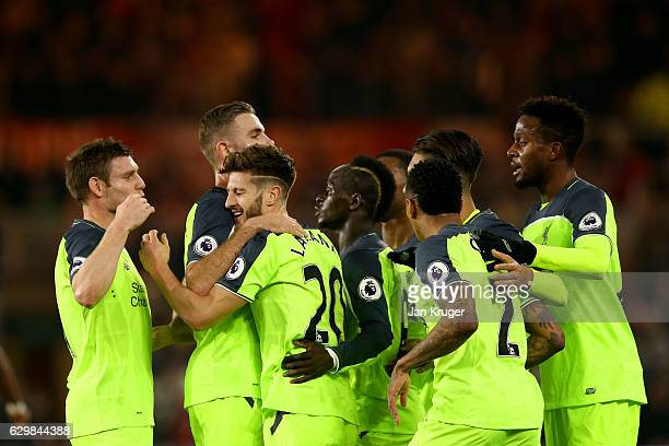 Adam Lallana of Liverpool celebrates scoring the opening goal with his team mates during the Premier League match between Middlesbrough and Liverpool...