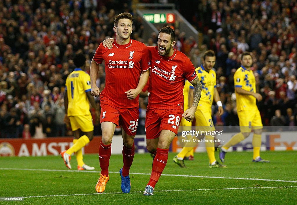 Adam Lallana of Liverpool (L) celebrates scoring the opening goal wth Danny Ings of Liverpool during the UEFA Europa League group B match between Liverpool FC and FC Sion at Anfield on October 1, 2015 in Liverpool, United Kingdom.