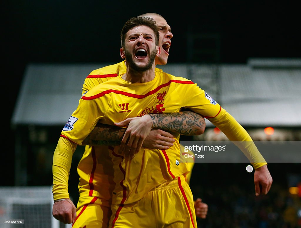 Adam Lallana of Liverpool celebrates scoring the second goal with Martin Skrtel of Liverpool during the FA Cup fifth round match between Crystal Palace and Liverpool at Selhurst Park on February 14, 2015 in London, England.