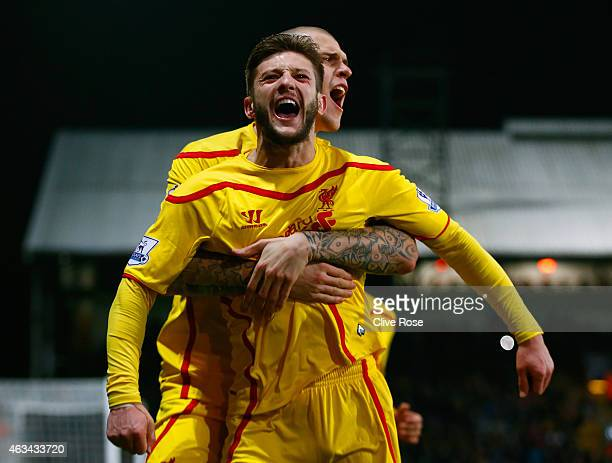 Adam Lallana of Liverpool celebrates scoring the second goal with Martin Skrtel of Liverpool during the FA Cup fifth round match between Crystal...