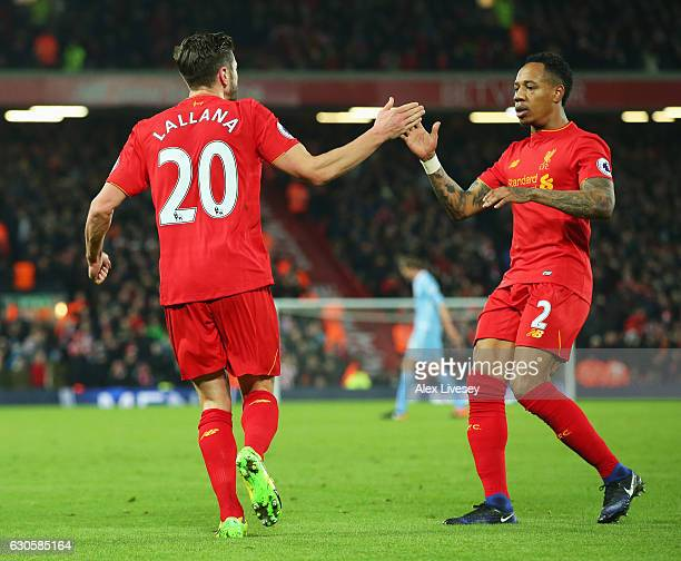 Adam Lallana of Liverpool celebrates with GNathaniel Clyne as he scores their first goal during the Premier League match between Liverpool and Stoke...