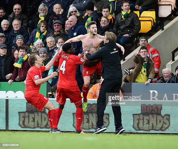 Adam Lallana of Liverpool celebrates with Jurgen Klopp manager of Liverpool and all his team mates during the Barclays Premier League match between...