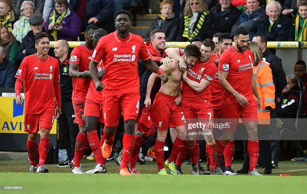Adam Lallana of Liverpool celebrates with Jurgen Klopp manager of Liverpool and all his team mates during the Barclays Premier League match between Norwich City and Liverpool at Carrow Road on January 23, 2016 in Norwich, England.