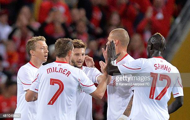 Adam Lallana of Liverpool celebrates with team mates after scoring a goal during the international friendly match between Brisbane Roar and Liverpool...