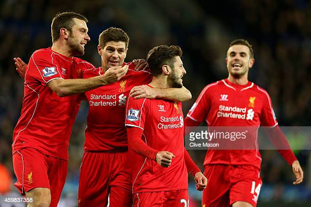 Adam Lallana of Liverpool celebrates with teammates after scoring a goal to level the scores at 11 during the Barclays Premier League match between...