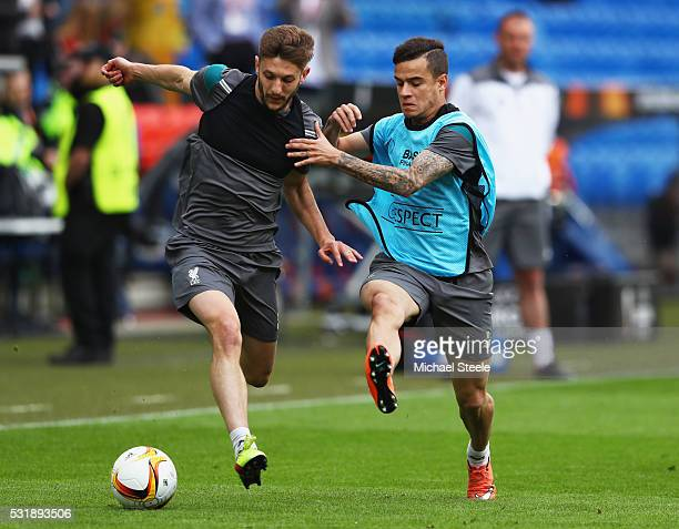 Adam Lallana of Liverpool challenges for the ball with Philippe Coutinho during a Liverpool training session on the eve of the UEFA Europa League...
